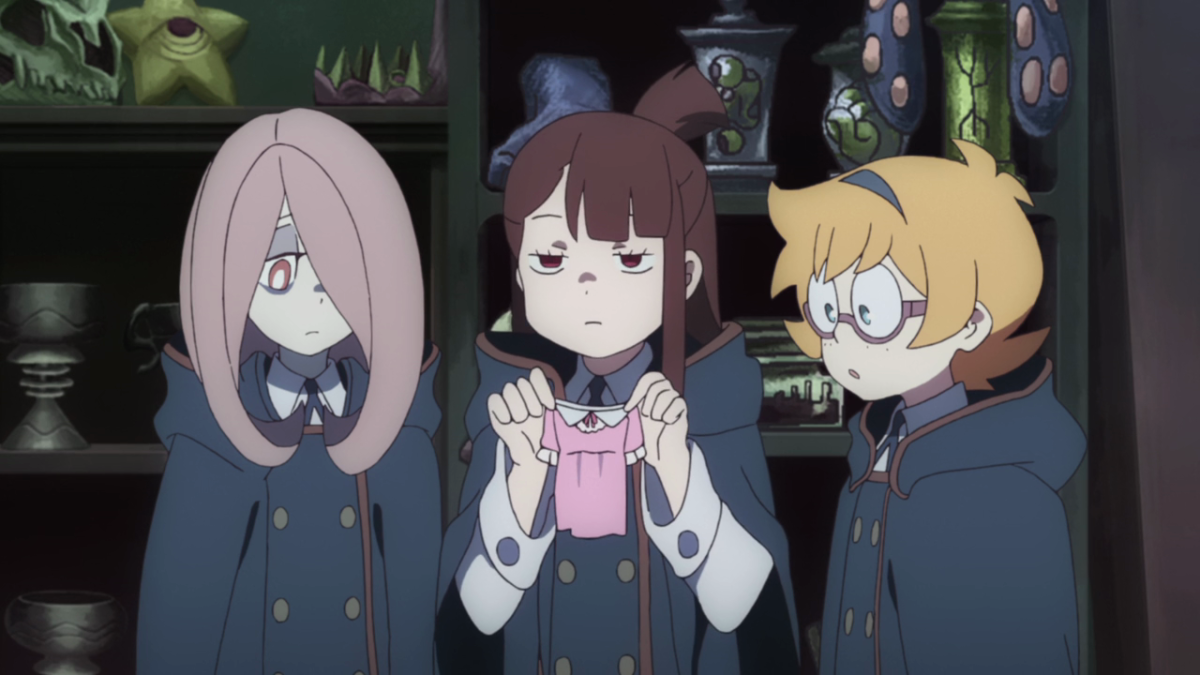 Sucy, Akko, and Lotte, in search of a magic dress, find that success is a tricky mistress.