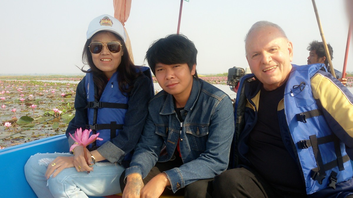 On a boat in the Sea of Red Lotuses.  From left to right:  wife, son-in-law, and author