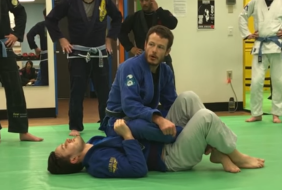 Getting into a backstep/kneebar position.