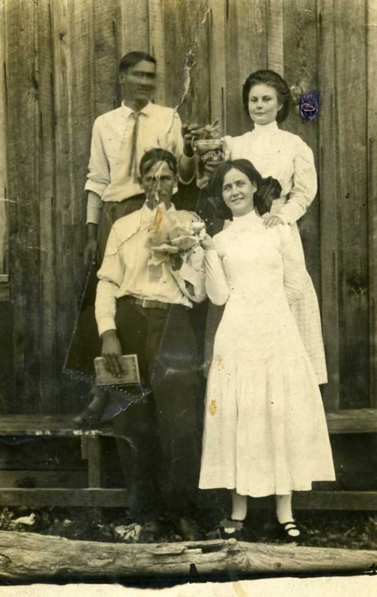 The lovely young lady in the back row is my maternal grandmother. This looks like it may have been taken at a church supper. No family member has been able to identify the other three young people in the photo, but neither man is my grandfather.