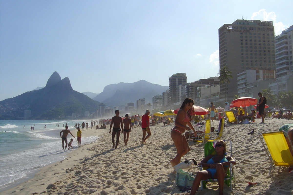 Ipanema, one of the most popular beaches in Rio, faces the Atlantic. In the background are the Two Brothers mountains and many high-rise buildings.