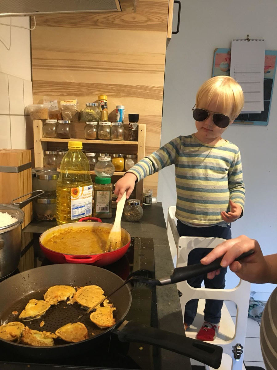 Here is my sous chef on his learning tower—sunglasses aren't part of the look normally.
