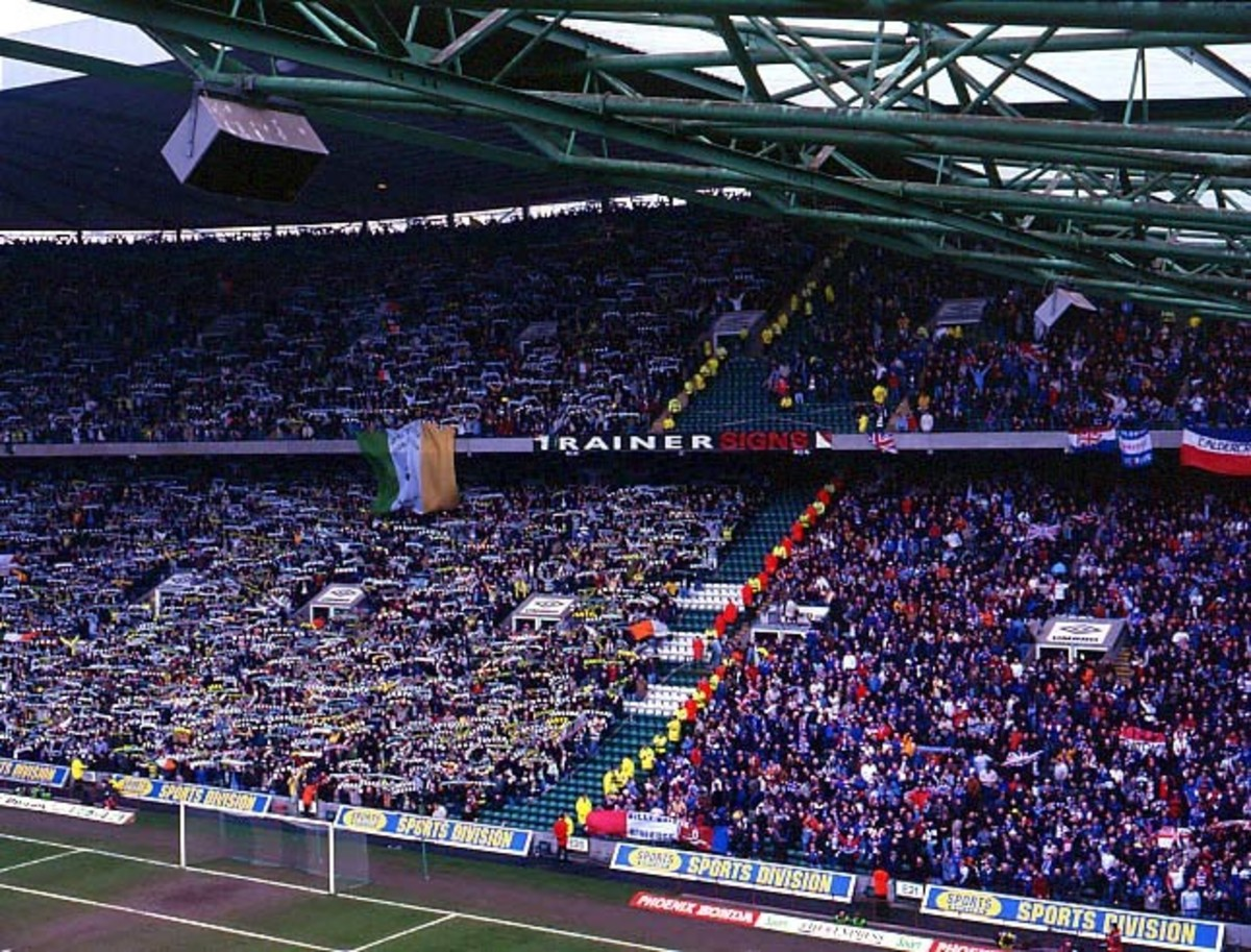 A photo showing both sets of fans at a match at Celtic Park. Celtic are on the left in green, Rangers are on the right in blue.