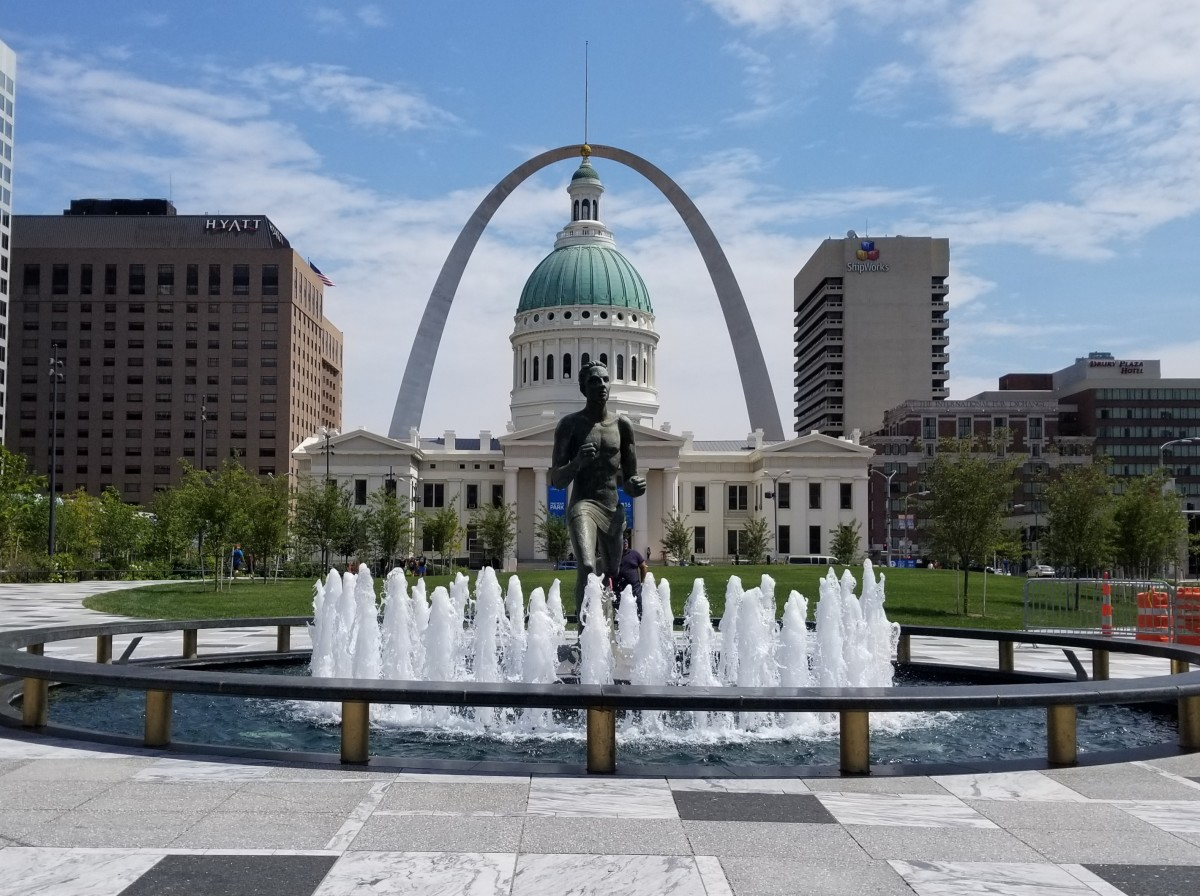 The Arch seen behind the Old Courthouse and Kiener Plaza.
