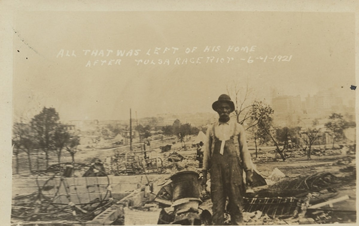 A resident stands amid the wreckage of his community.