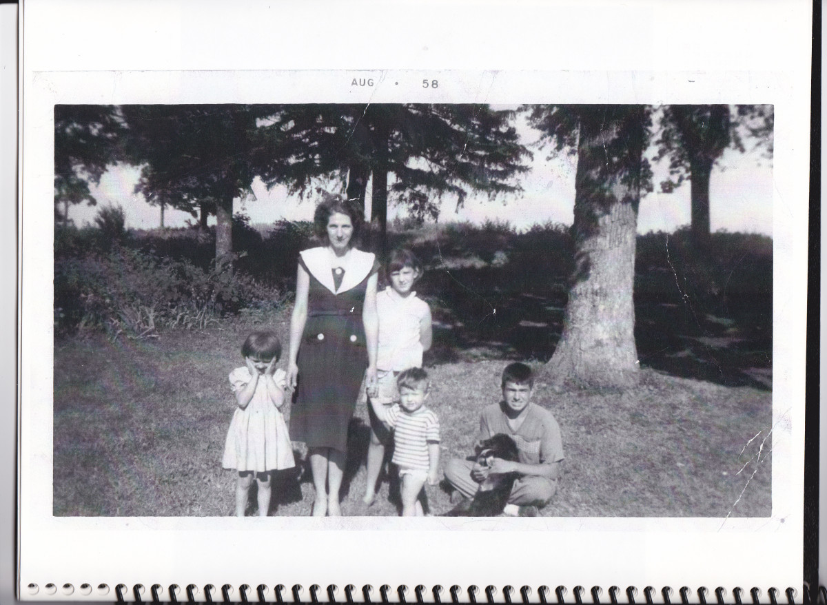 Picture taken in 1958 in our front yard.  From left to right:  sister Patty, mom, sister Beatrice, brother Philip, and the author with dog sitting.