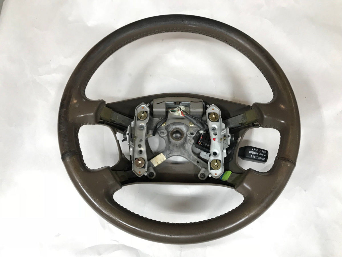 Lexus ES300 steering wheel obtained from a salvage yard before refinishing.