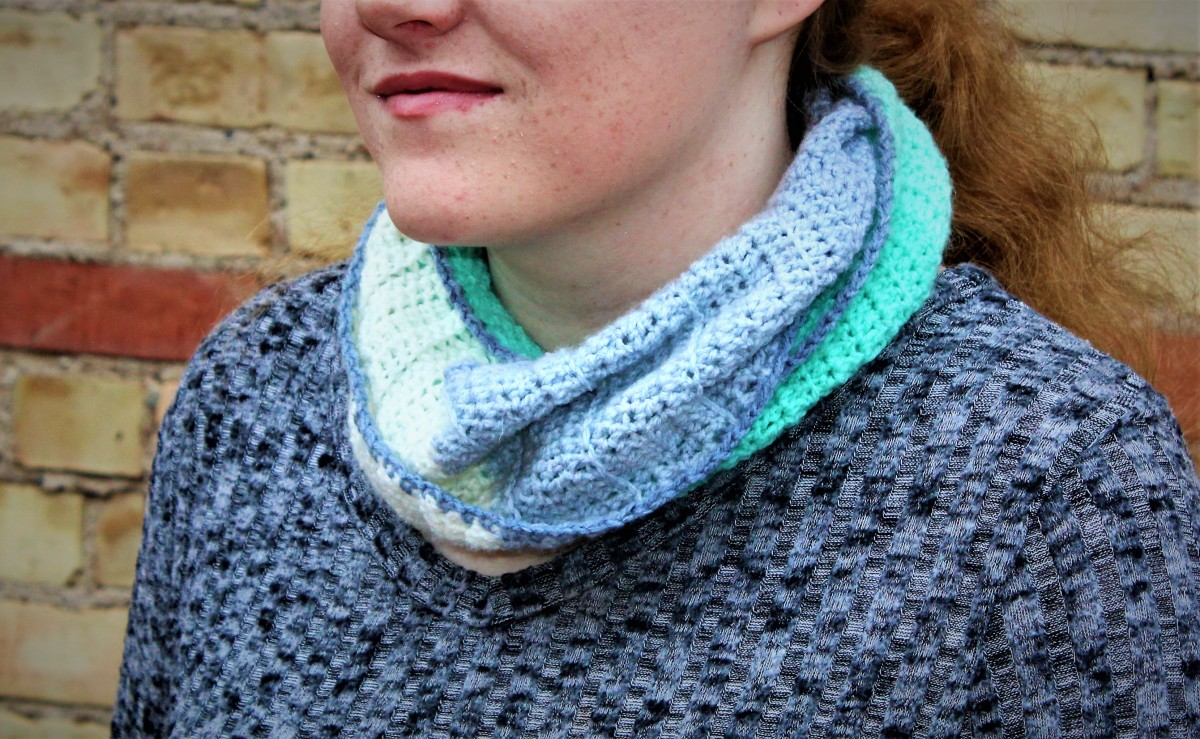 This crocheted infinity scarf is lightweight and versatile!