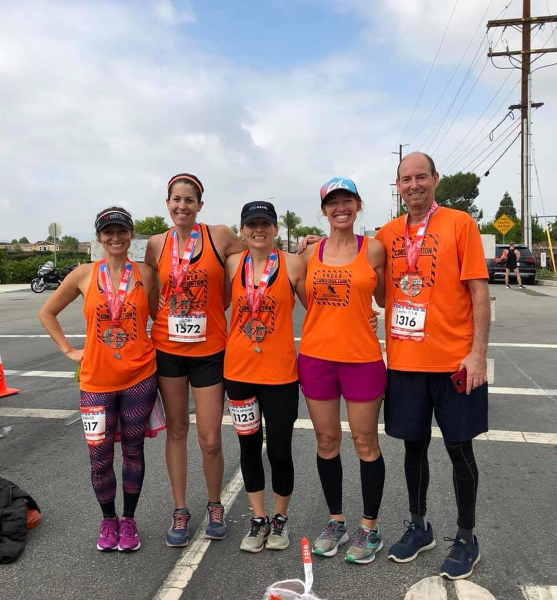 Photo of Eric Coggins with Corona Girls of Crossroads Running Community
