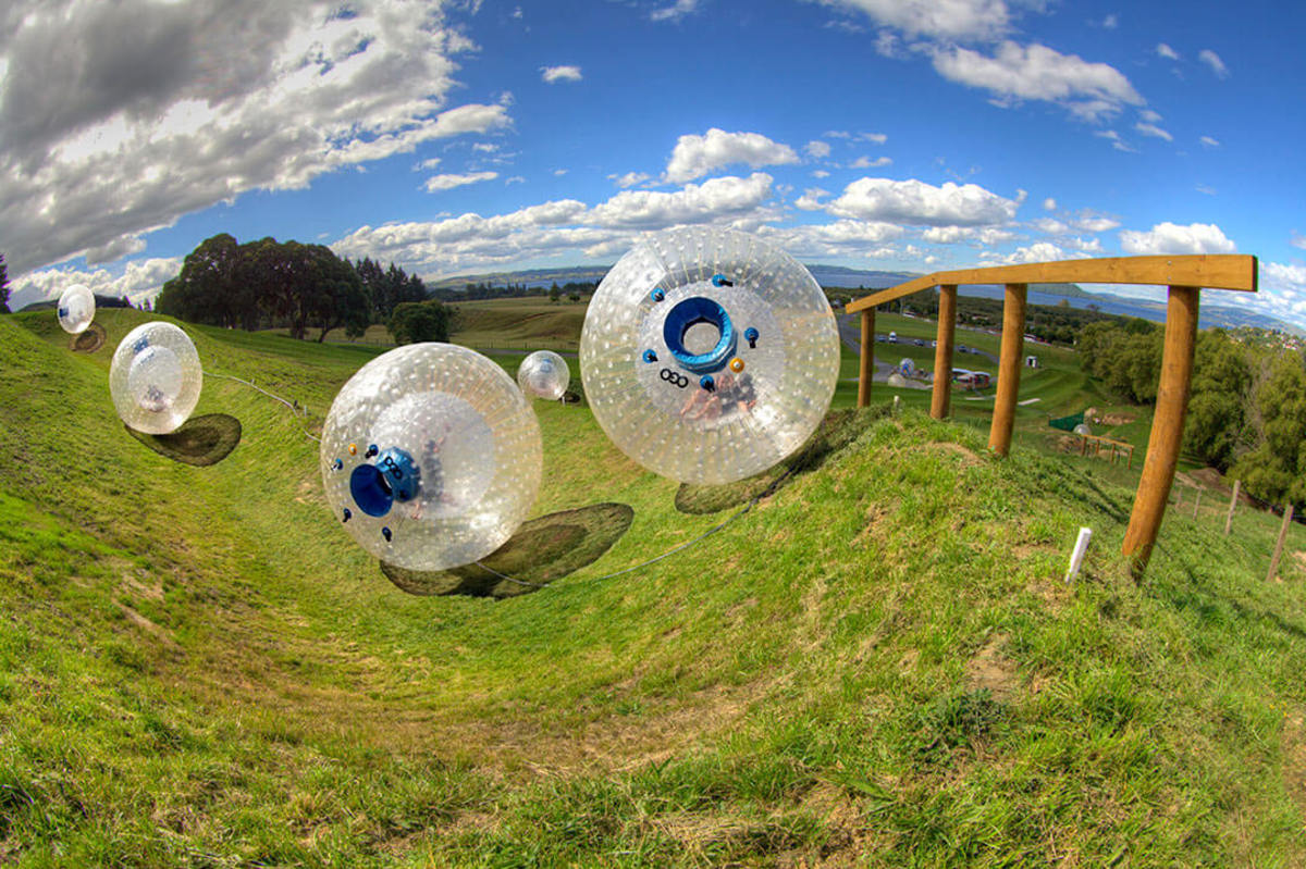 Zorbs rolling down the hill