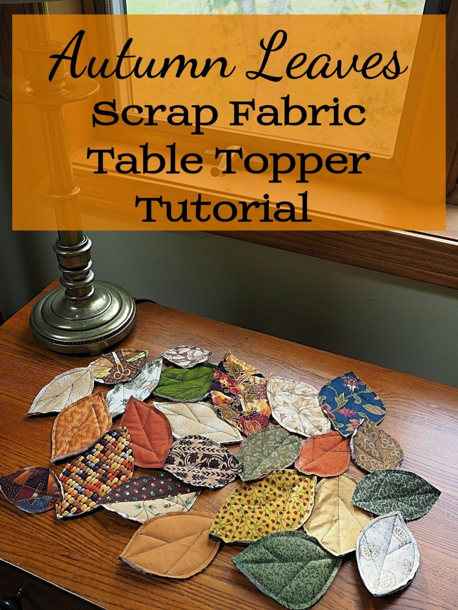 Make this festive fall leaves table runner, or topper, out of fabric scrap quilted leaves.