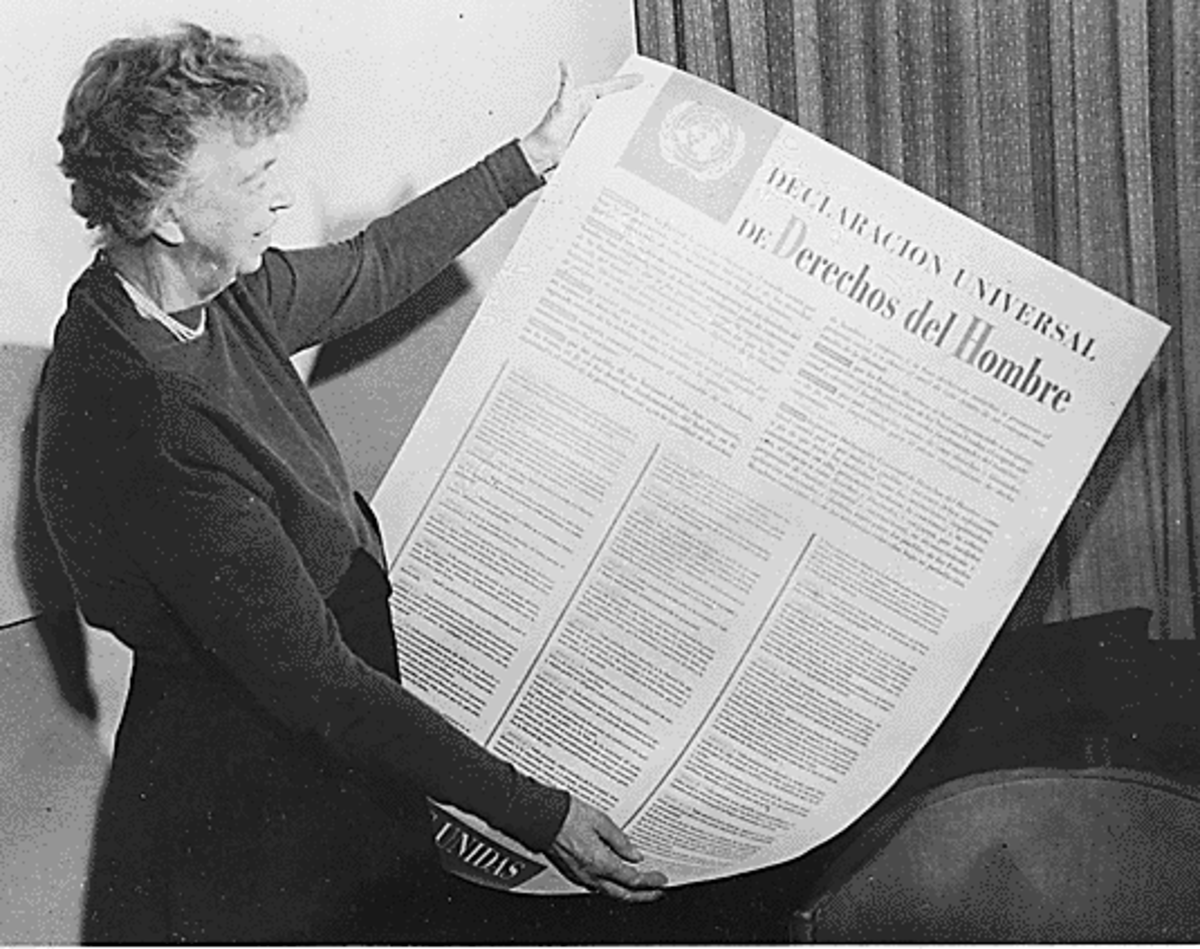 First Lady, Eleanor Roosevelt holding up the Universal Declaration of Human Rights.