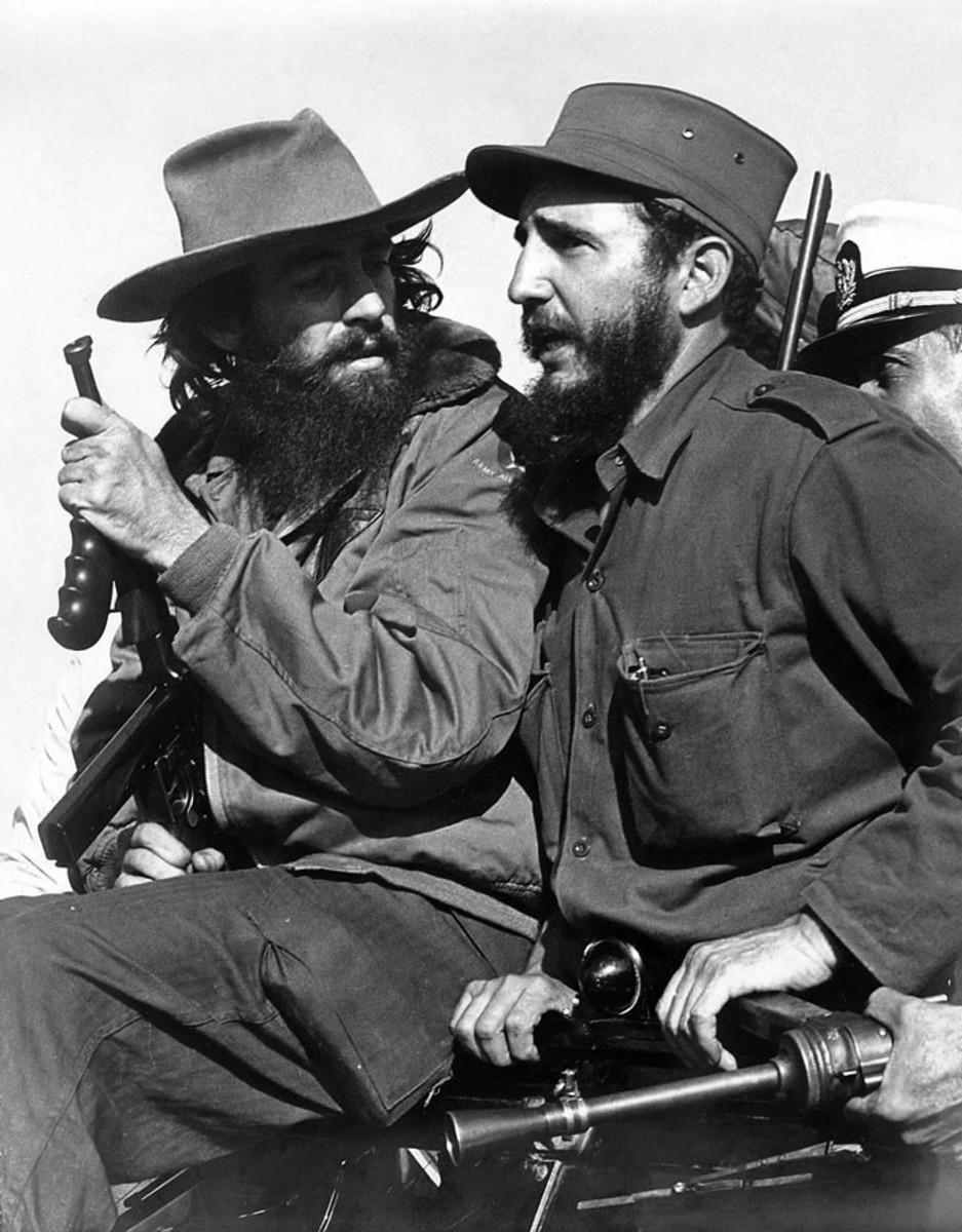 Castro (right) with fellow revolutionary Camilo Cienfuegos entering Havana on 8 January 1959.