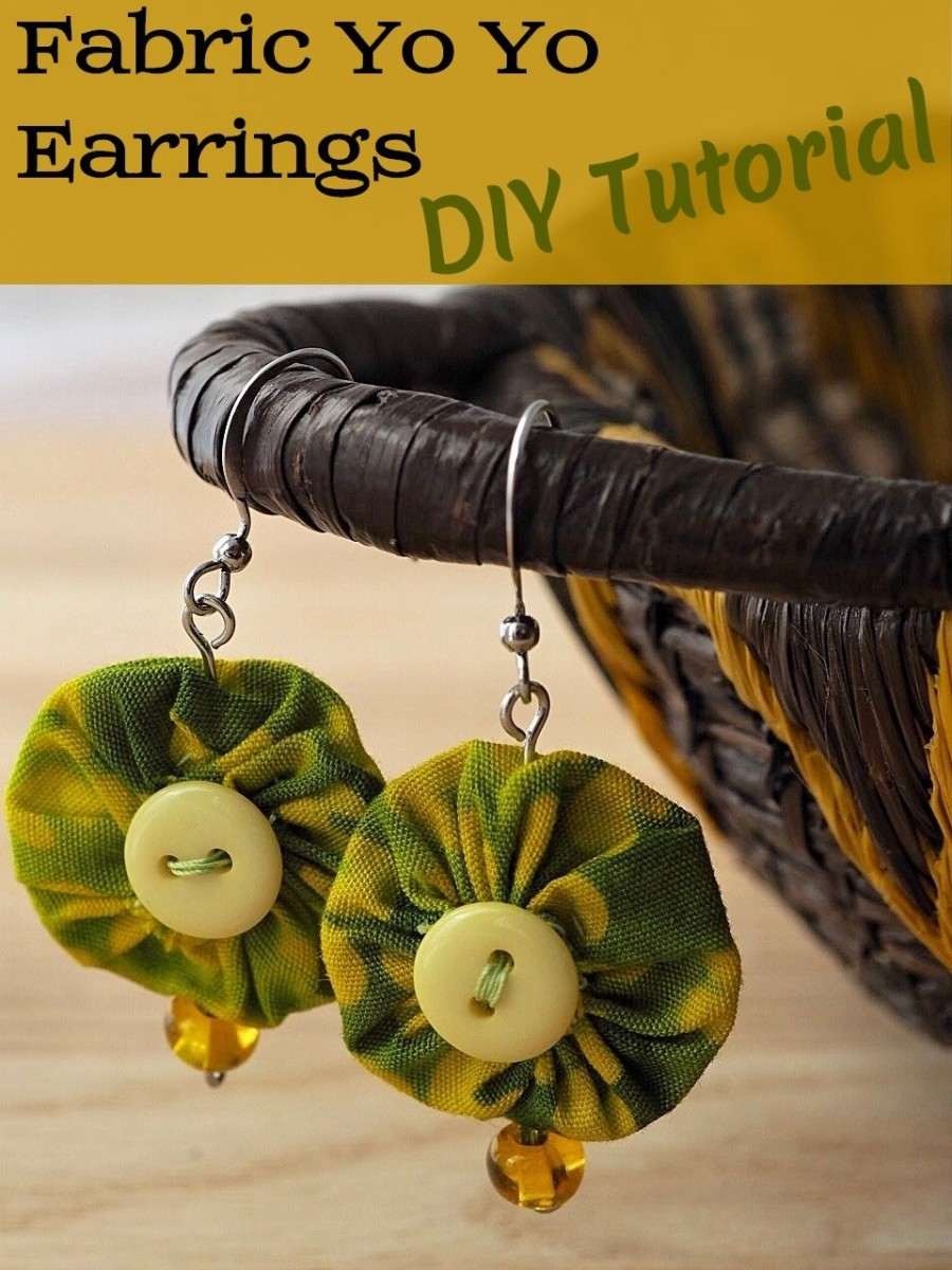 These unique yo yo earrings made with fabric scraps, a couple of buttons, and some beads, are easy to make with this DIY tutorial.  They put a new twist on an old-fashioned quilting technique.