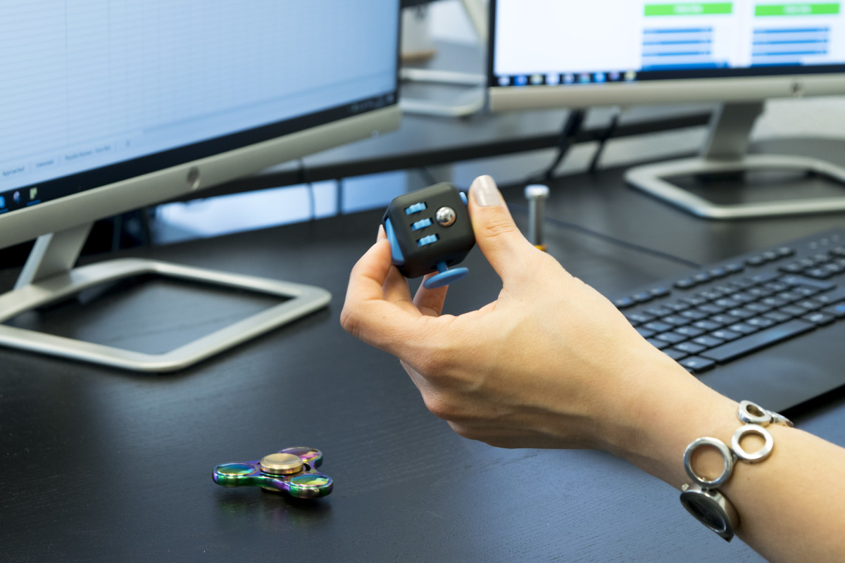 The fidget cube being used in an office. Small and discreet. I would have shown you mine, but I lost it somewhere.