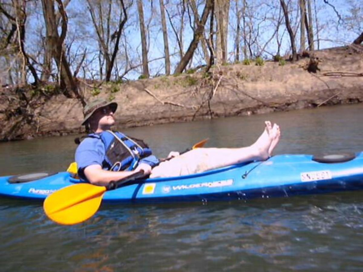 Your illustrious author reclining while floating down a local creek.