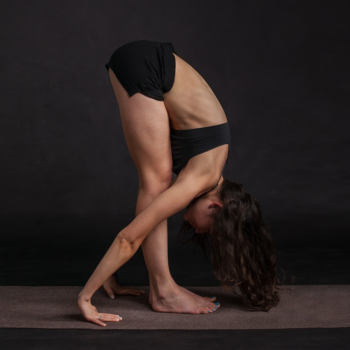 Standing forward fold pose is thought to relieve stress, fatigue, and mild depression.