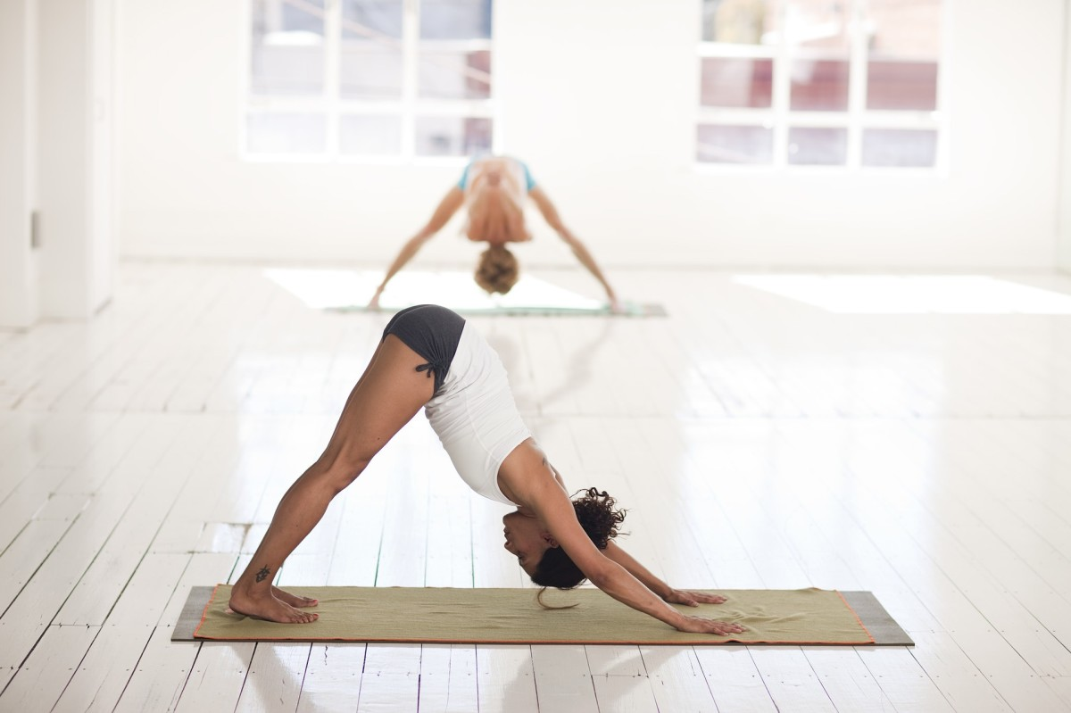 Downward facing dog calms the mind and relieves stress.
