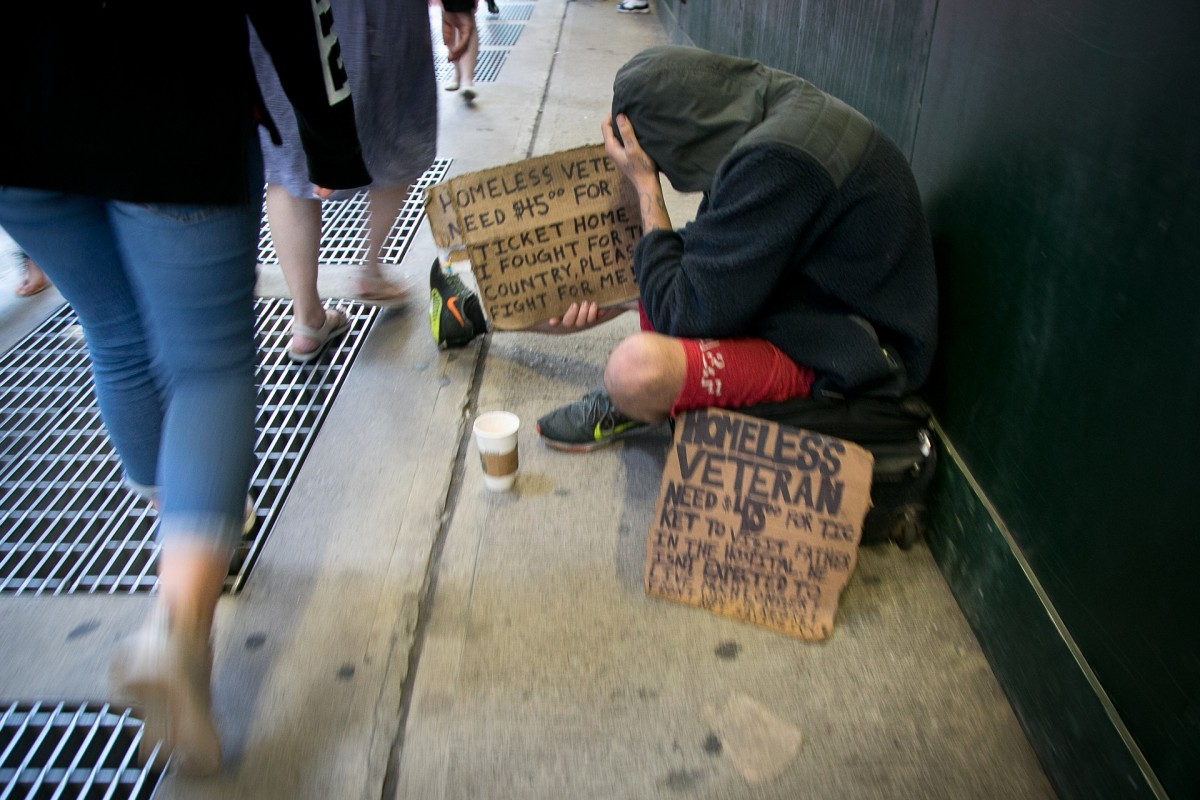 Toss some spare change to a busker, or homeless person.
