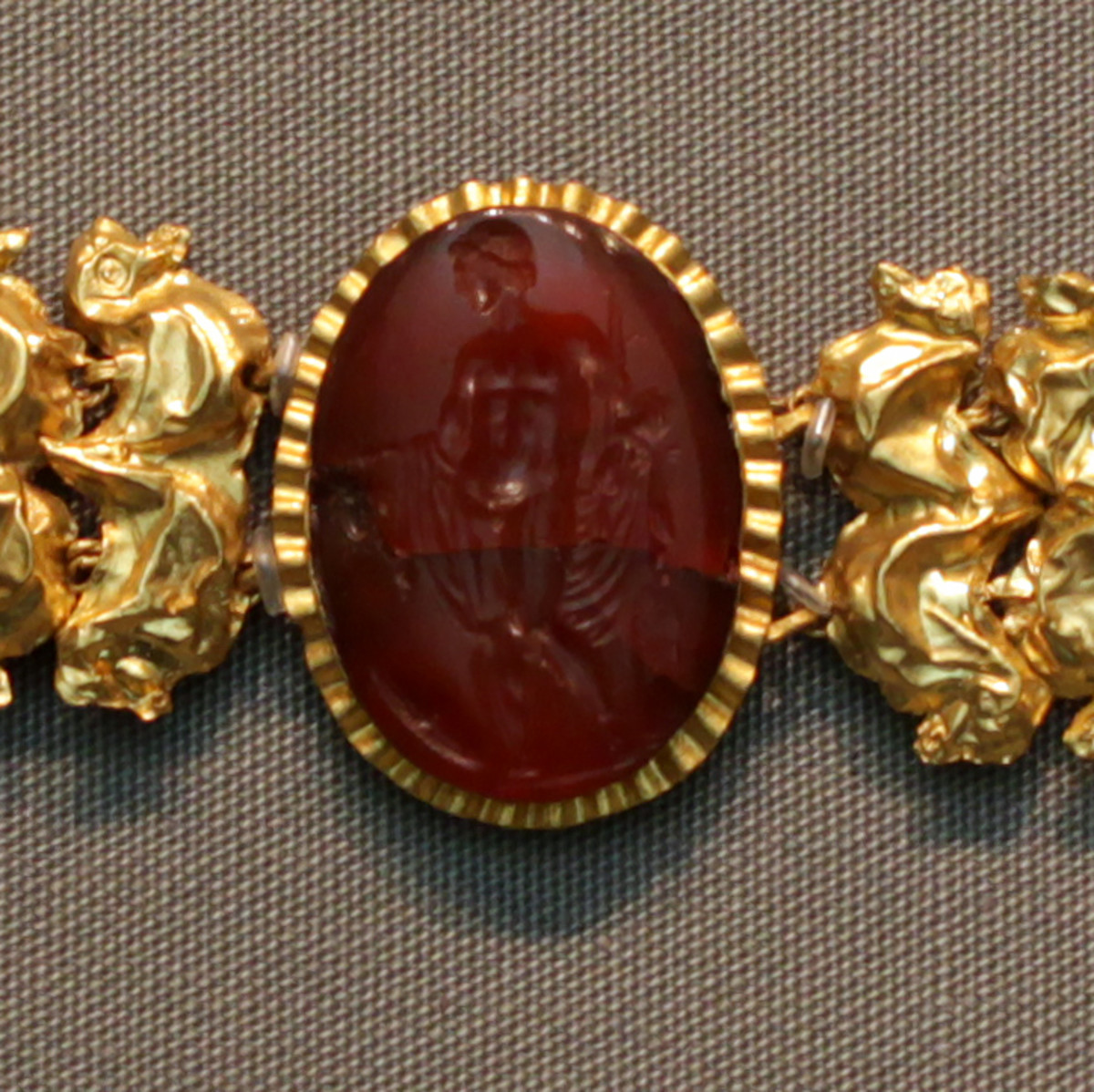 An image of engraved carnelian. This gemstone was highly valued in ancient times, often made as engraved jewelry used as protection.