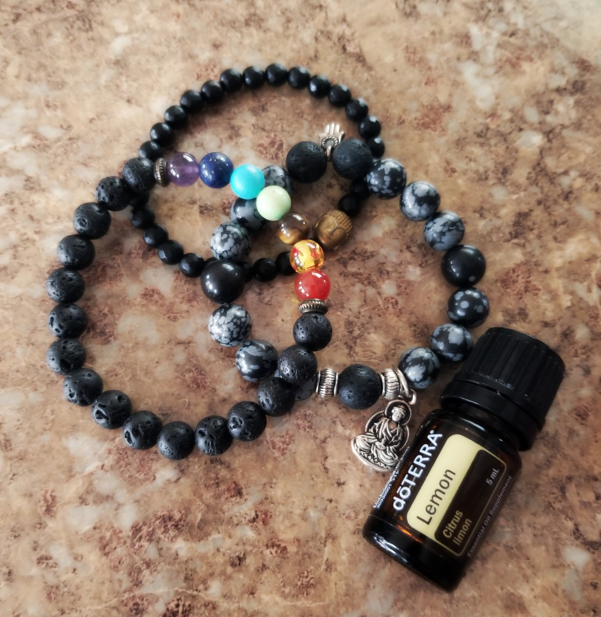 Lemon essential oil and a diffuser bracelet are an uplifting combination.