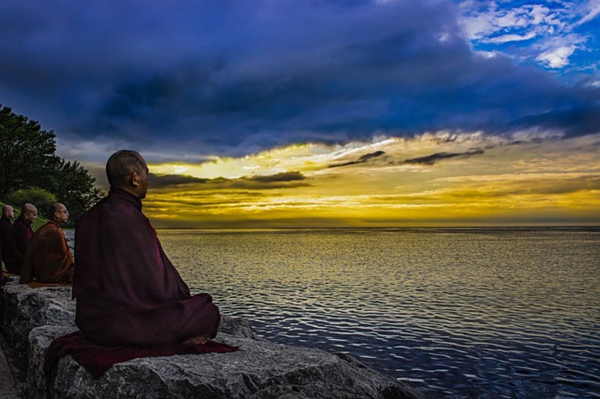 Monks meditating by water. Image by: truthseeker08