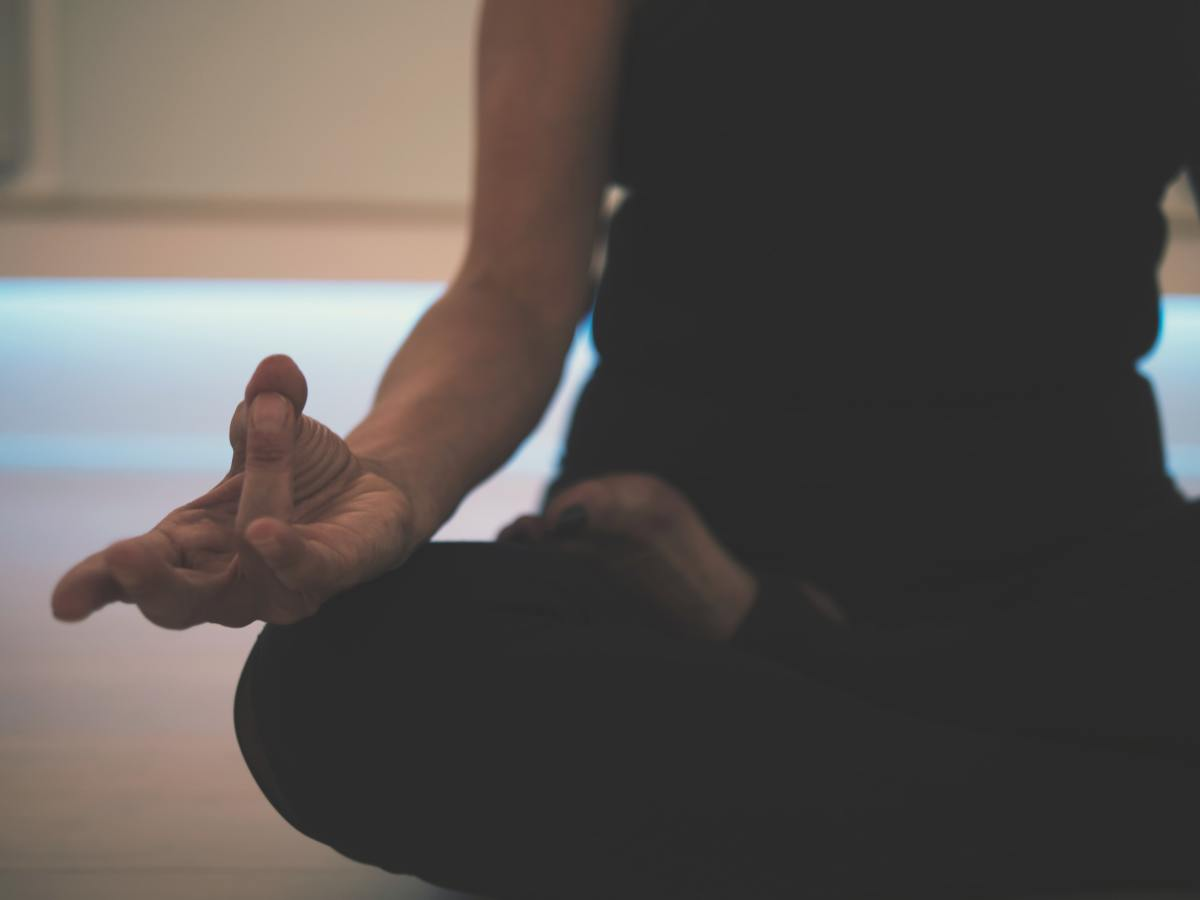 A close-up of the lotus position, demonstrating the mudra hand positioning.