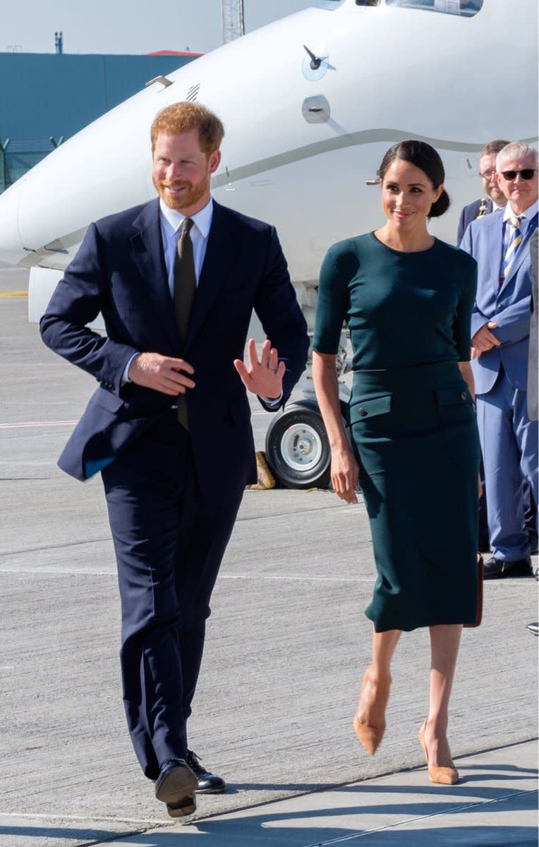 Meghan Markle arrives in Ireland in a forest green Givenchy outfit.