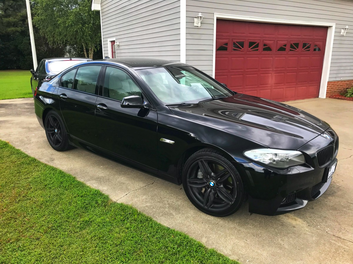 Matte black Plastidip on 2011 BMW 550i M Sport Package wheels.