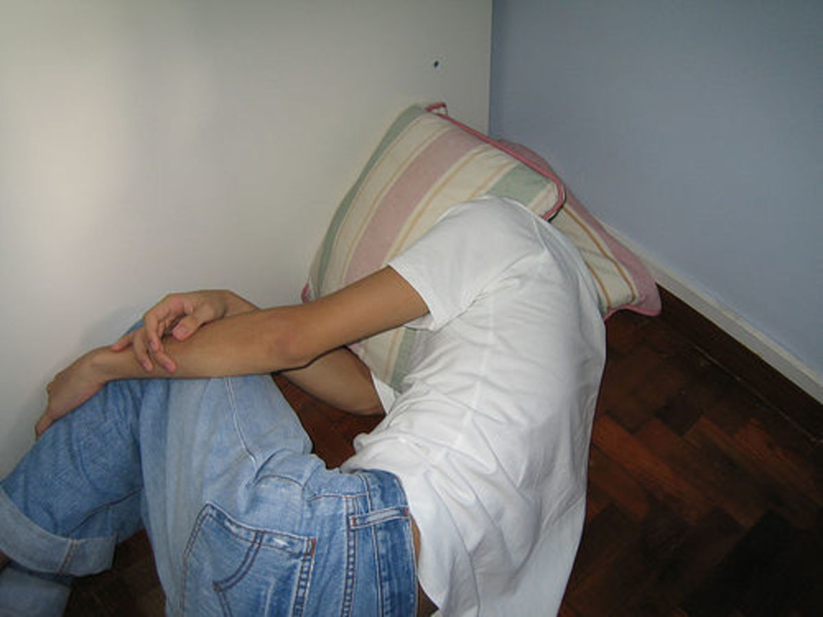 Find cushions or pillows for the head of someone having a nonepileptic seizure.