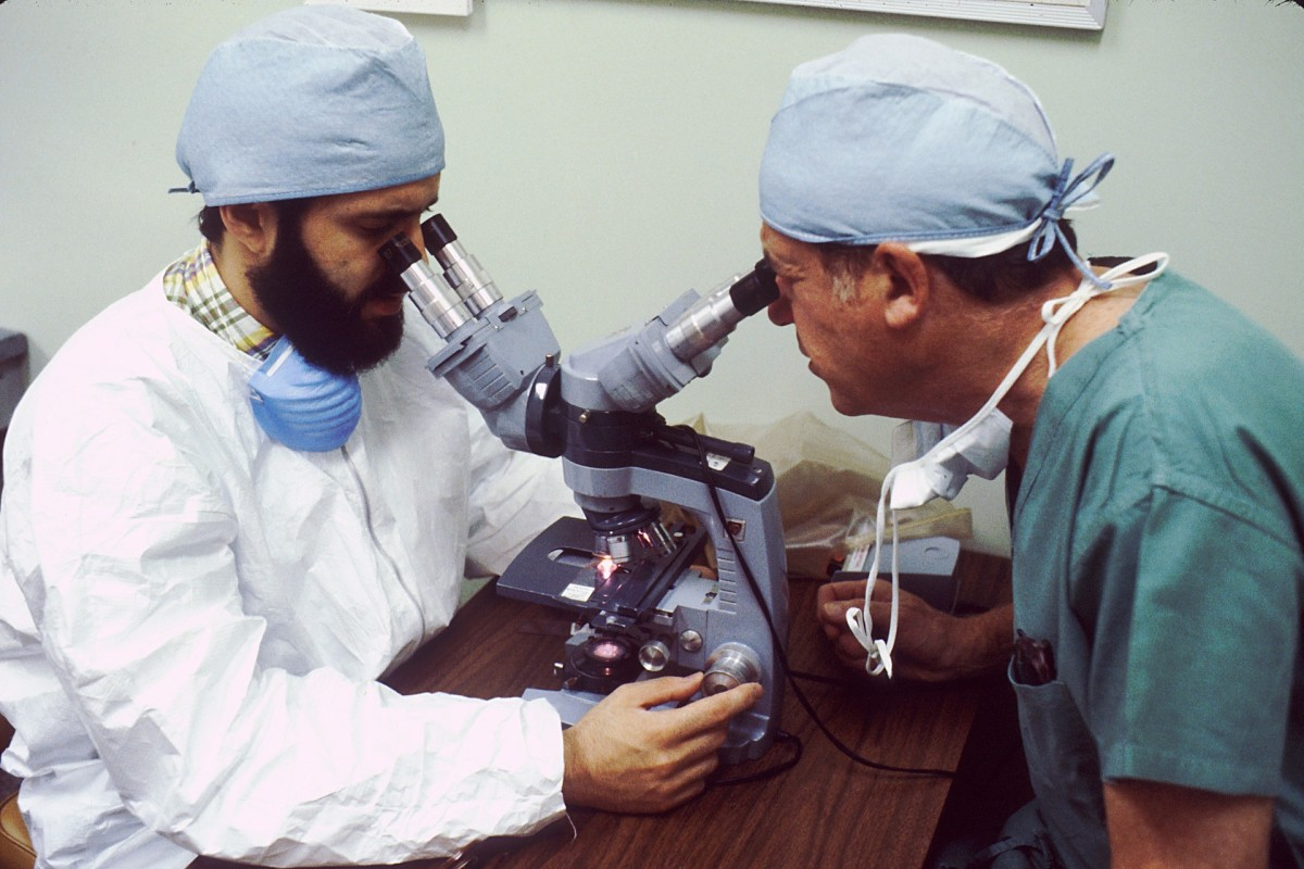 Pathologist and Surgeon Looking at a Frozen Section Slide