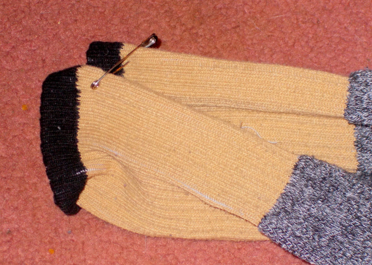 Using pins to keep socks together will help with laundry as well as dressing for the person with a visual impairment.