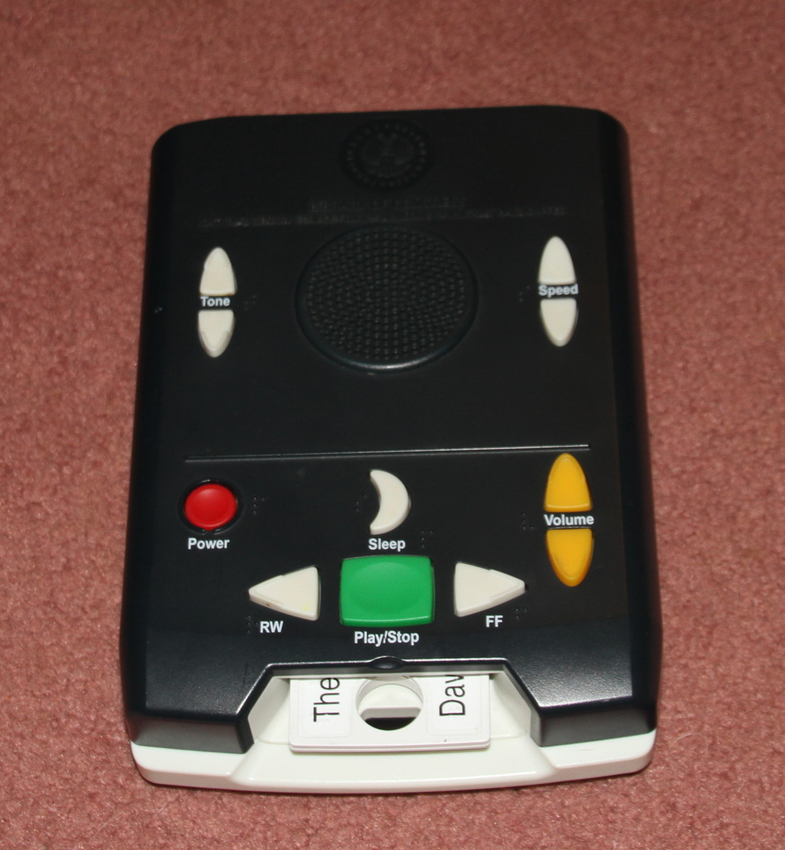 This talking book player plays books recorded on special cartridges. This device allows people to listen to books rather than use their reduced vision to read them.