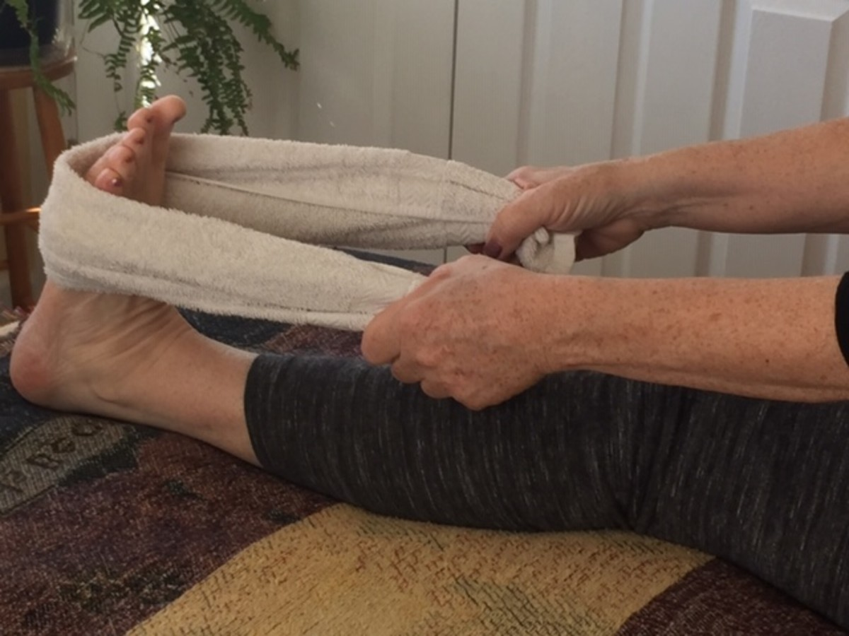 Keep the knee straight to stretch the gastrocnemius muscle. Pull the towel back until you feel a stretch all along your calf.