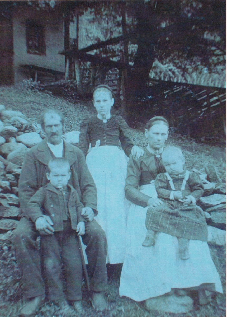 My paternal grandmother at the age of 13 in Austria.  She is pictured with her father, stepmother and step siblings.  Picture taken around 1900.