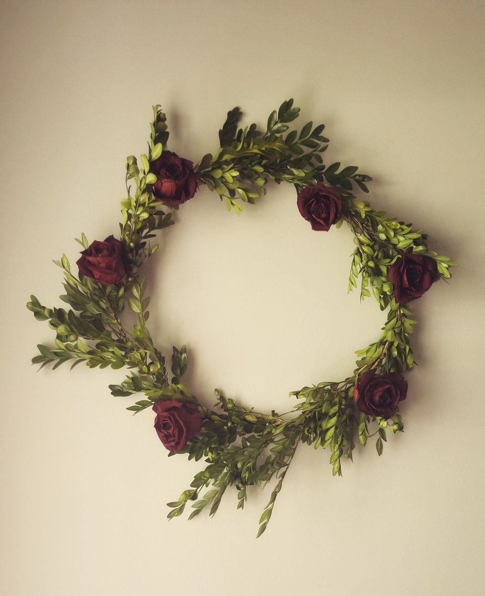 Beautiful dried rose and boxwood wreath.