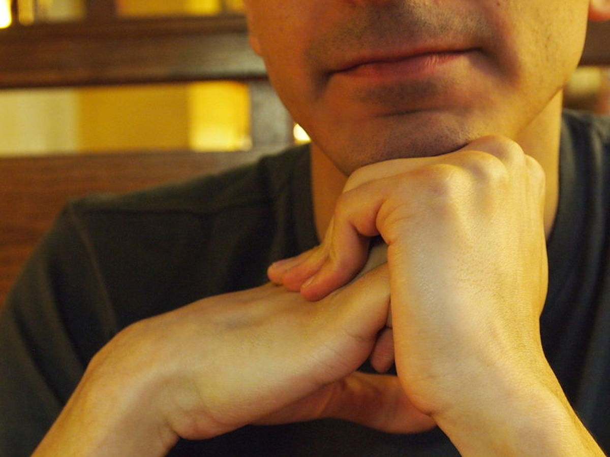 Cracking one's knuckles can pose such a source of noise--for those around you.