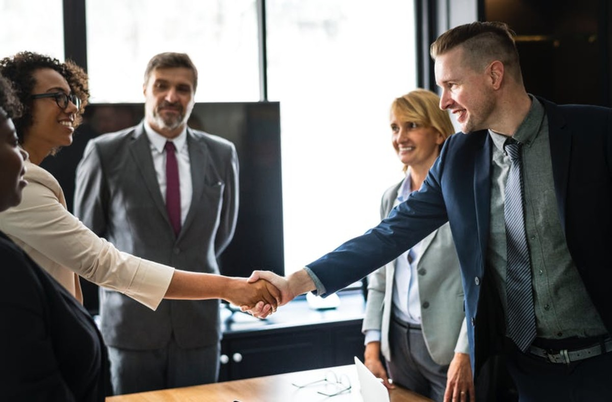 Office Quiz: Is this the proper handshake for women and men? Answer: Yes. The man and woman should NOT be any closer than what you see here.