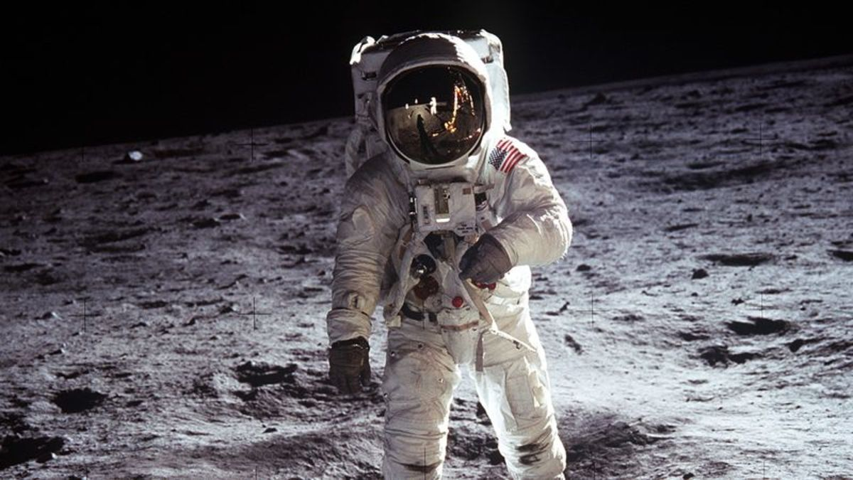 Buzz Aldrin walks on the moon during the Apollo 11 mission.