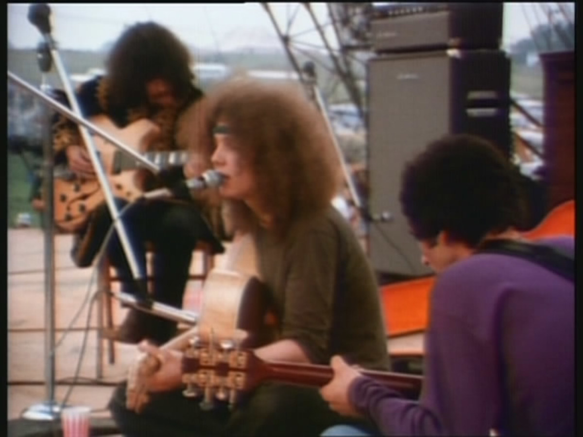 Bert and his backing musicians onstage at Woodstock