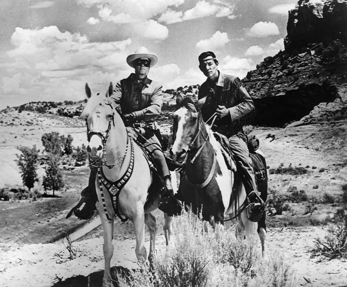 From left,  Clayton Moore as the Lone Ranger on Trigger left, and Jay Silverhills as Tonto (Harold Preston Smith) his horse Scout.
