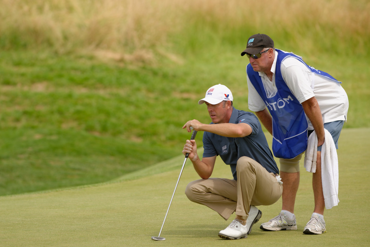 Australia's Richard Green and his caddie read the 9th-hole green during round 3 of the French Golf Open at the Golf National in Saint Quentin en Yvelines, Saturday July 6th 2013.