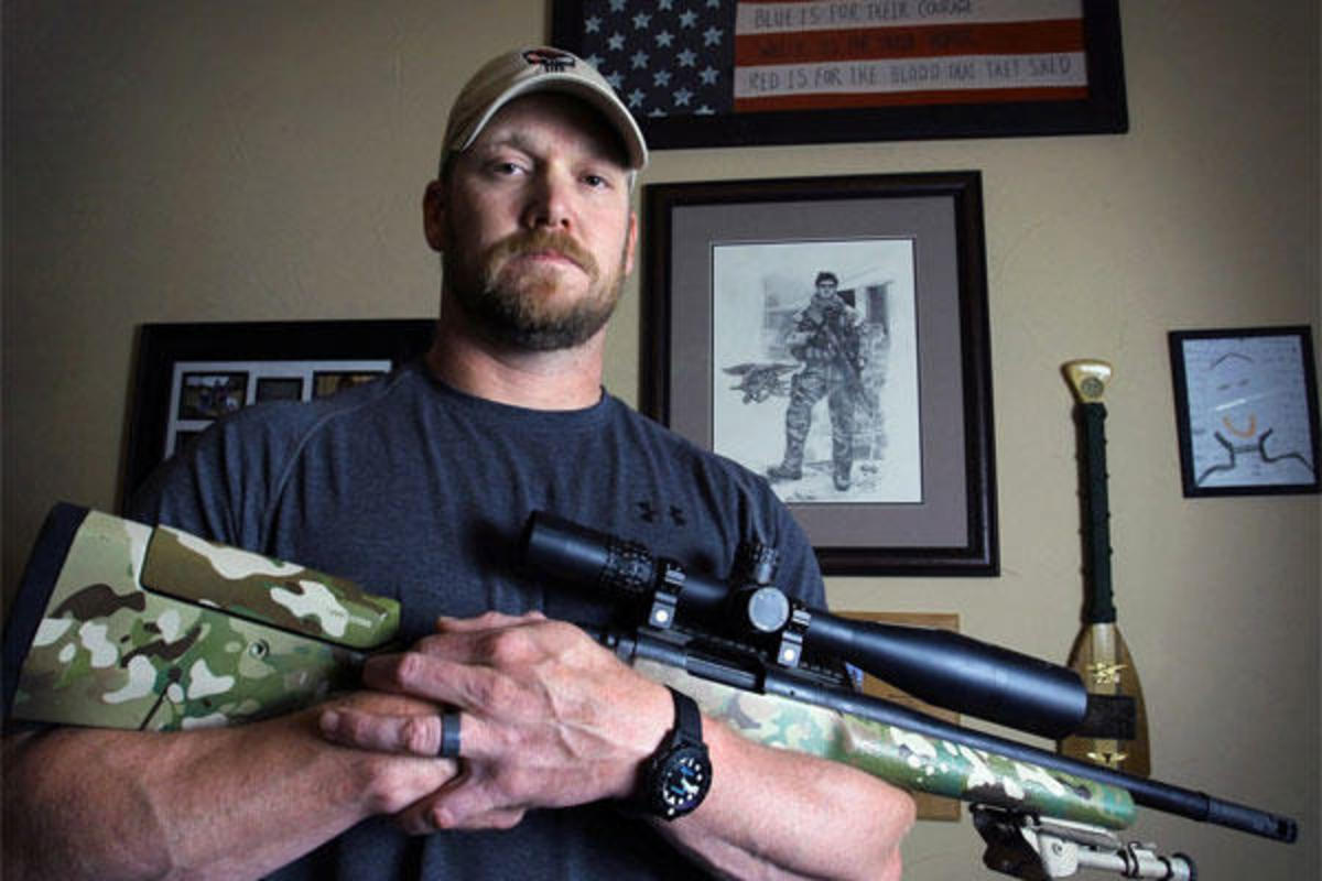 Chris Kyle poses for photo with his rifle.