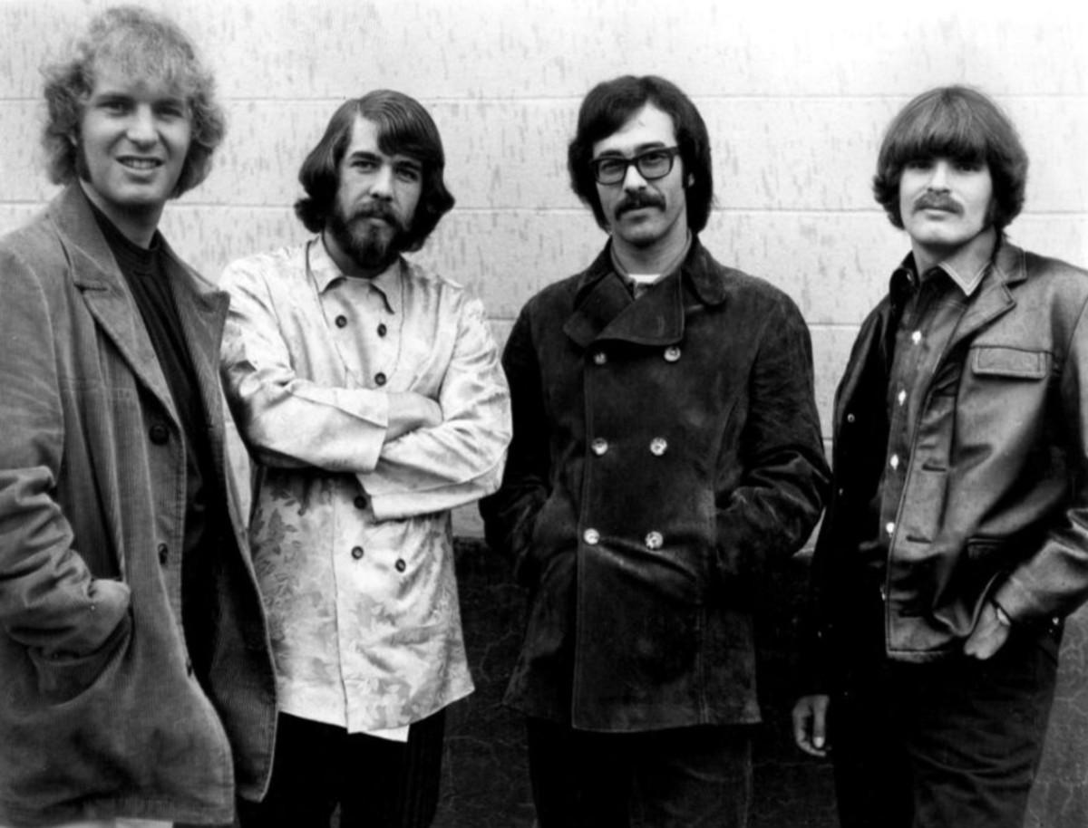 Photograph of Creedence Clearwater Revival 1968  L-R Tom Fogerty/  Doug Clifford;  Stu Cook and John Fogerty. Fantasy Records. John Fogerty. Fantasy Records.