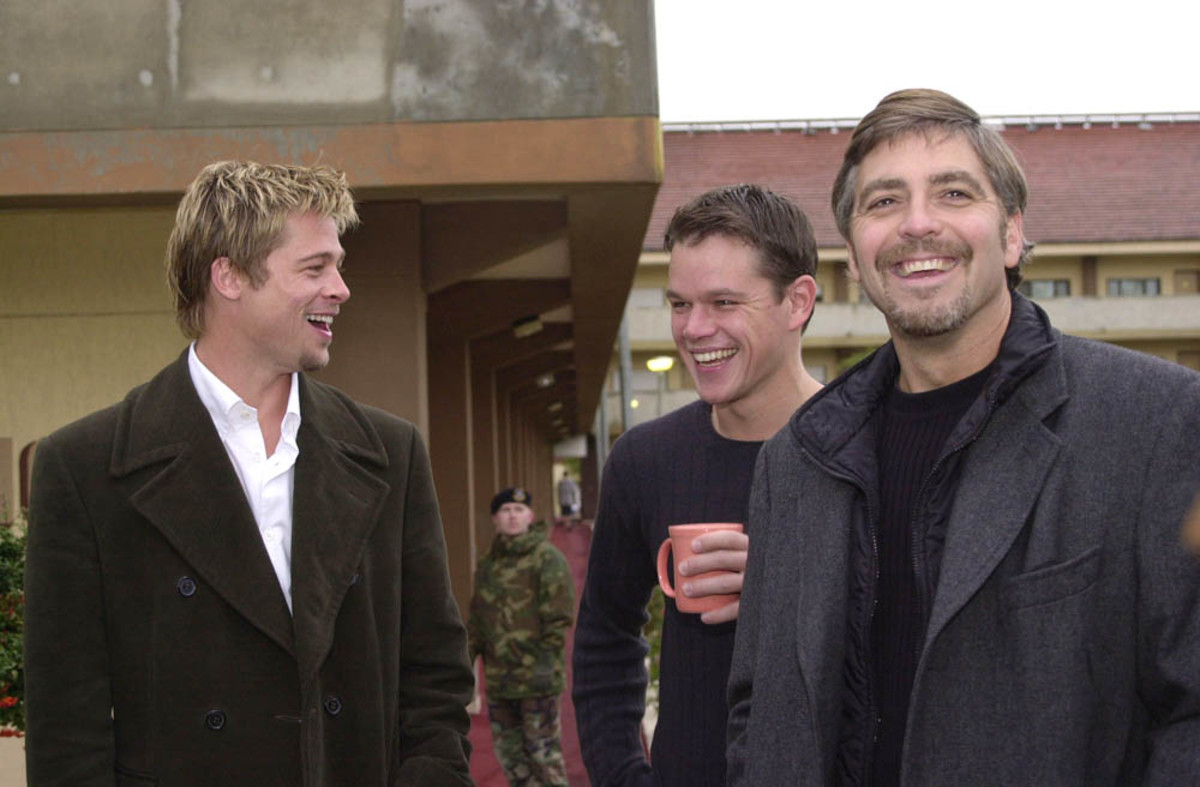 Clooney, Pitt, and Damon ham it up for the camera.