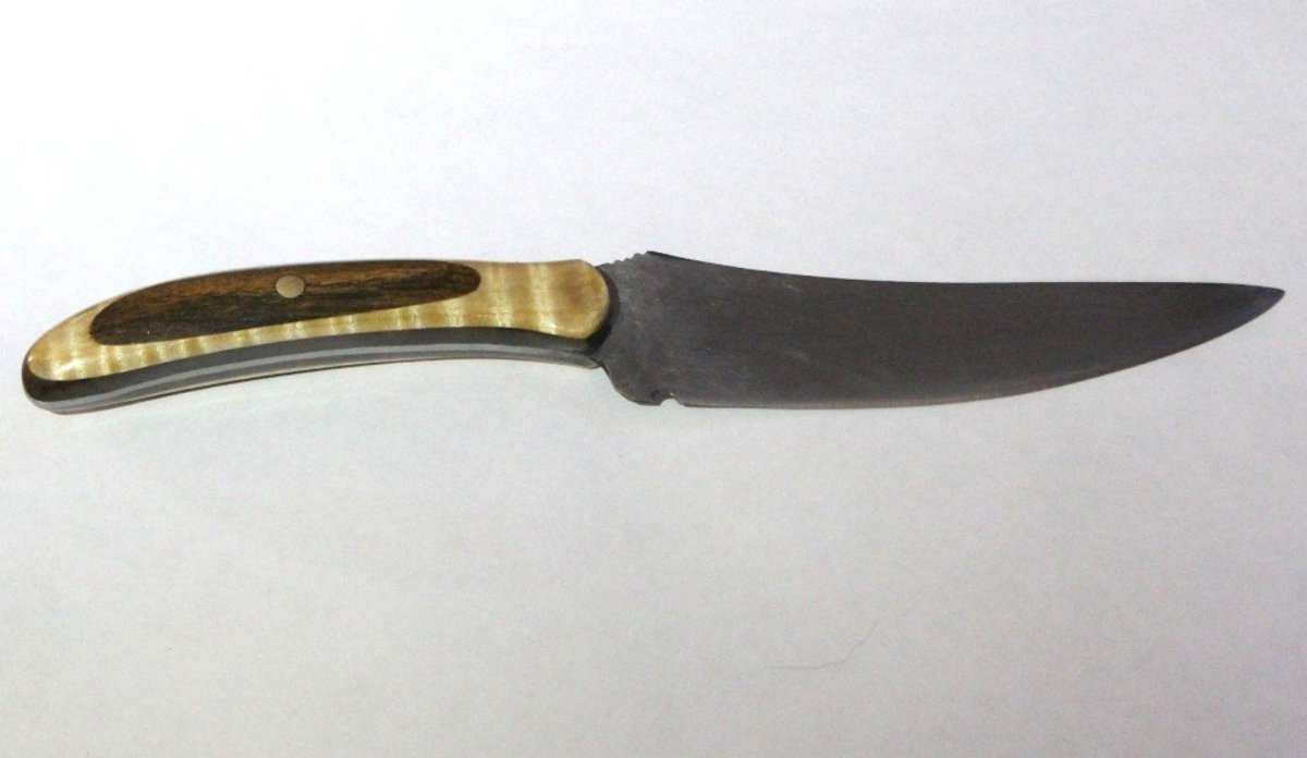 Finished knife made from an old table saw blade.