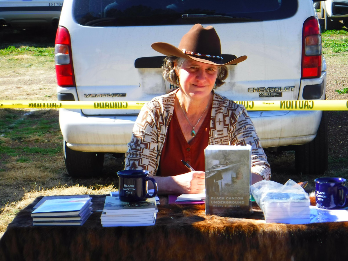 Open-air book signing at a community event.
