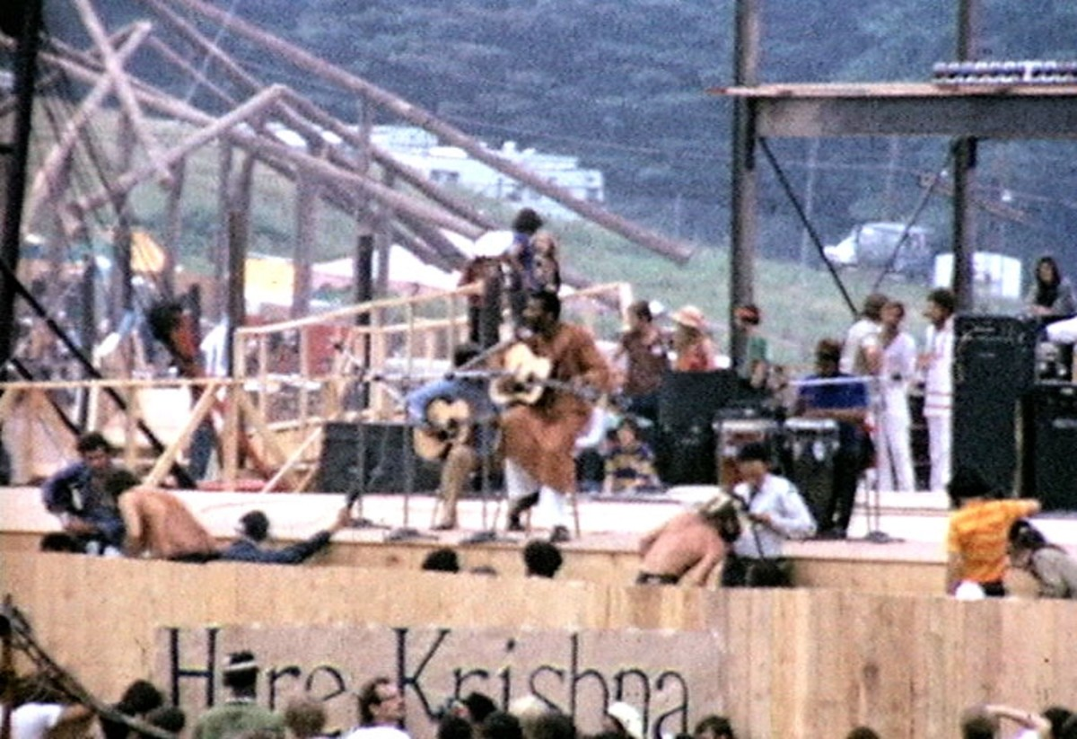 Richie Havens onstage at Woodstock. He was the first performer at the festival.
