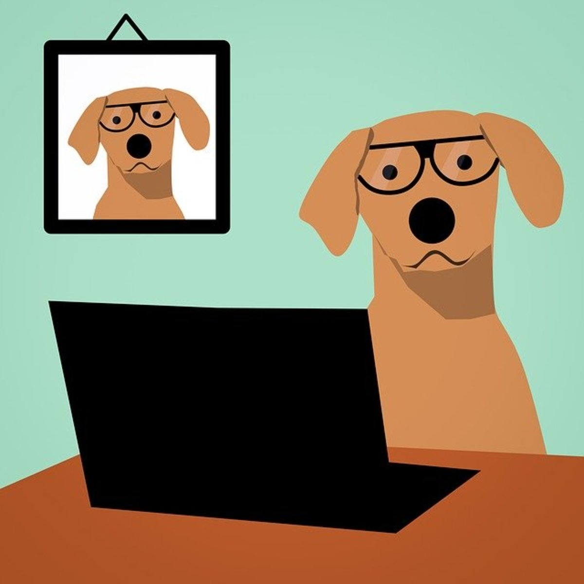 Dog wearing glasses using laptop