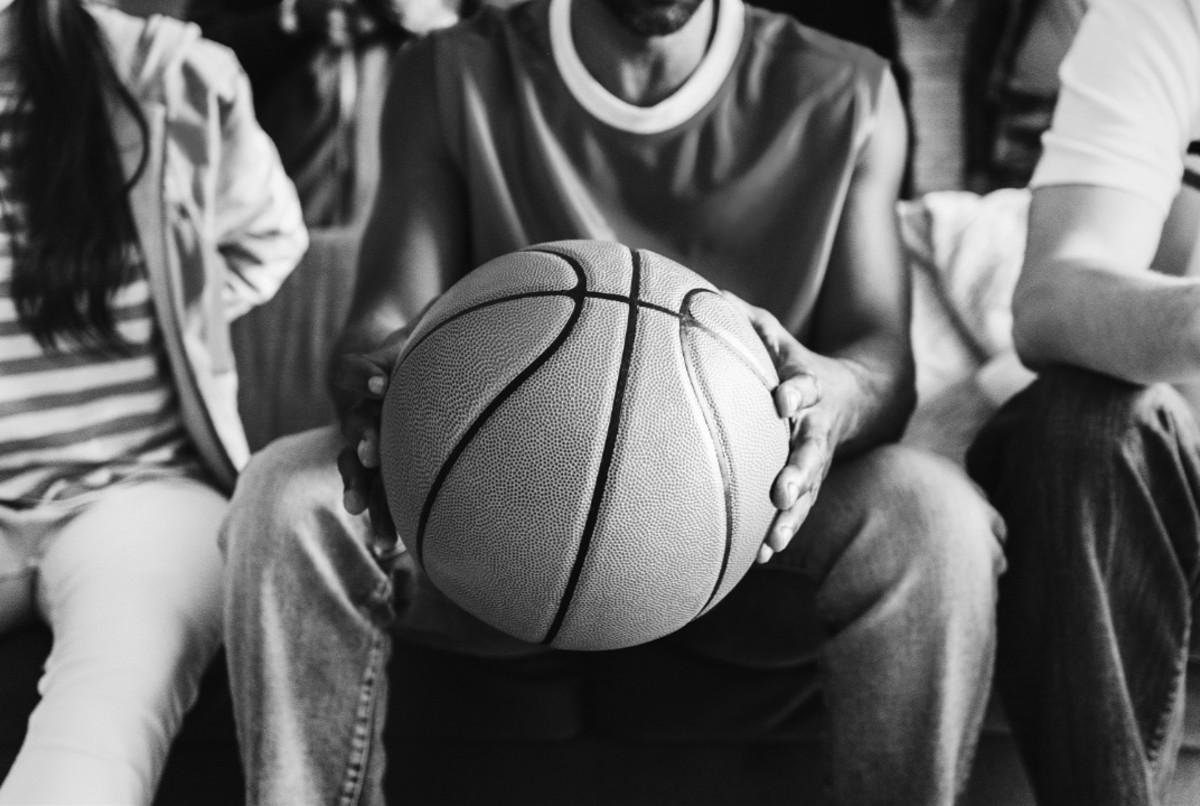 A man holding a basketball.